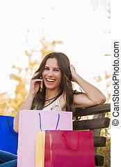 Happy Shopper - Happy shopper on the phone