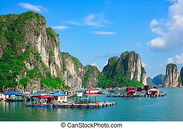 Floating village near rock islands in Halong Bay