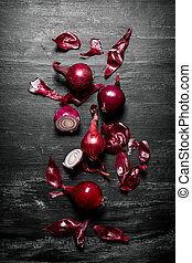 Red onion . On black rustic background. - Red onion . On the...