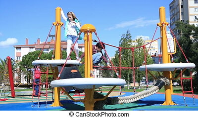 Children playing at the playground - Two elementary aged...