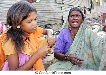 Poverty Woes - A streetside teenage girl is worried as her...