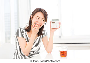 electronic calculator - Woman of the smile having an...