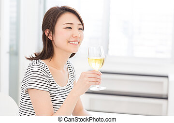 woman who drinks wine - young attractive asian woman who...