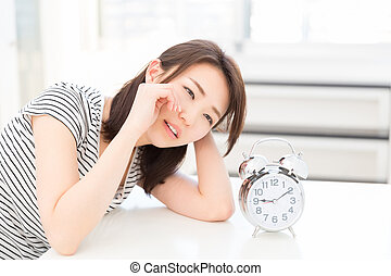Woman to see a clock - young attractive asian woman to see a...