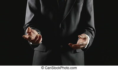 Young businessman presenting and explaining on black background