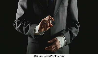 Young businessman making hand gestures for transparent...