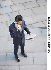 Above view of an Asian Business man. - Overhead view of a...