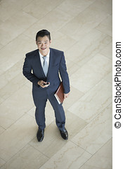 Above view of a Chinese businessman. - High angle view of a...