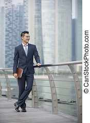 Asian businessman looking away - Portrait of a happy Asian...