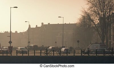Busy Road Near Houses At Sunrise - Heavy traffic cars and...