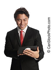 Attractive businessman with digital - A good looking...