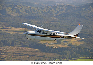 light aircraft - Single engined light aircraft flying over...