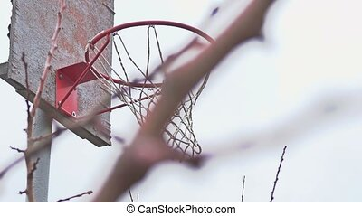 old basketball hoop on the street with a grid - old...