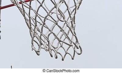 old basketball hoop on street with a grid - old basketball...
