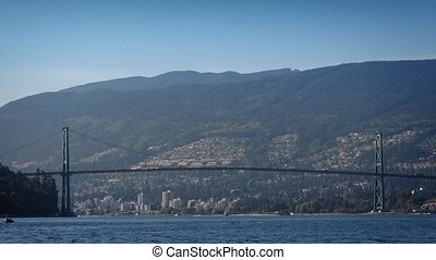 Busy Suspension Bridge Over Water - Wide shot of long...