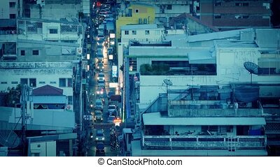 Cars Light Up City Avenue At Dusk - Stream of traffic...