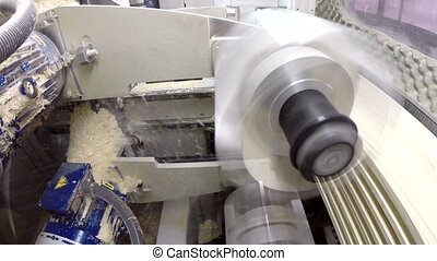 Cutter sawing wood View from inside machine - Cutter sawing...