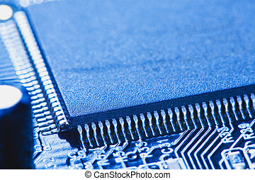 microchip integrated on motherboard - closeup electronic...