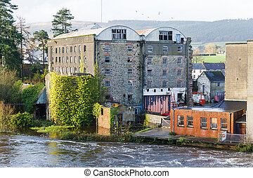 River flooding the buildings - Photo of Suir river flooding...
