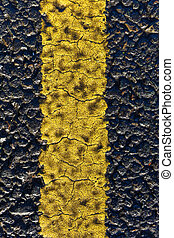 Asphalt road and painted yellow line - Close up photo of...