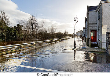 Flooding river in an irish town - Photo of a flooding river...