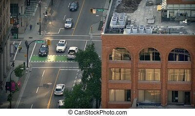 City Intersection In The Evening - Birdseye view of cars...