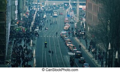 City Intersection With Huge Crowds - Cars and trams on a...