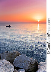 Adriatic Sunset - Man in a boat angling at sunset