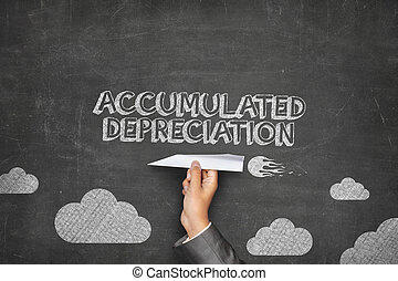 Accumulated depreciation concept on blackboard with paper...