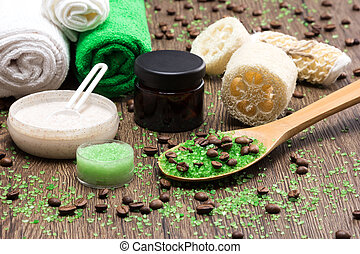 Spa and cellulite busting products on wooden surface -...