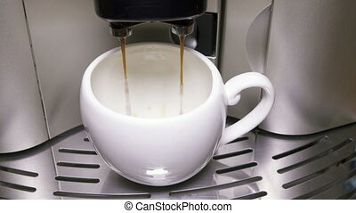 Coffee flows in a cup ,