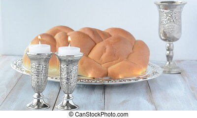 Shabbat candles Challah and wine - Shabbat candles with...