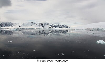 Reflection of Antarctica Mountain in water surface