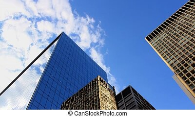 Office Towers With Moving Sky - Looking up at huge office...
