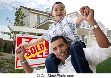 Hispanic Father and Son in Front of Their New Home with Sold...