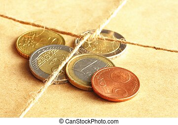 forwarding charges or shipping money concept with coins and...