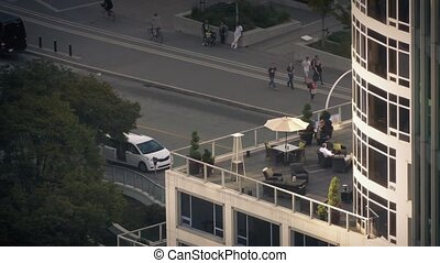 People Sitting On Apartment Balcony - People enjoying...
