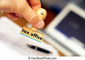 tax - pay your taxes concept with stamp in office and...