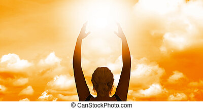 Woman Holding the Sun as a Motivational Concept Abstract