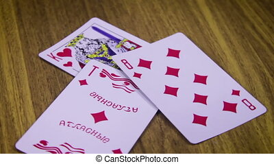 Playing Cards Rotates on a Wooden Table - Pack of playing...