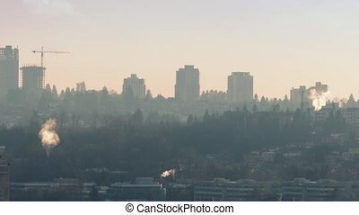Smoke Rises From Chimneys Sunset - Cityscape in beautiful...
