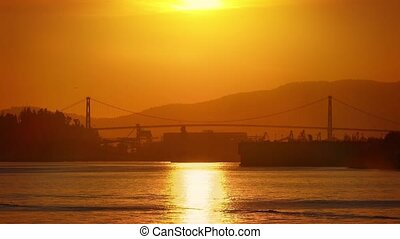 Suspension Bridge And Shipping Area - Calm water with bridge...