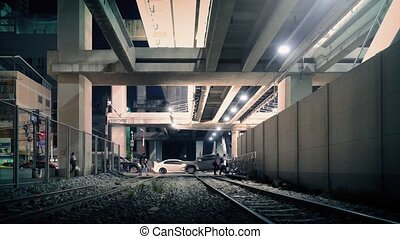 City Underpass With Train Tracks - View of city street...