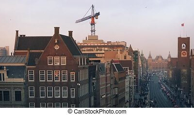 View Over City Skyline In Evening - Historic buildings and...