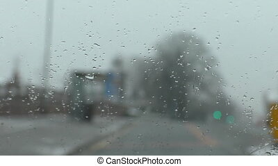 Driving sleet focus on windshield - Wet windscreen in focus,...