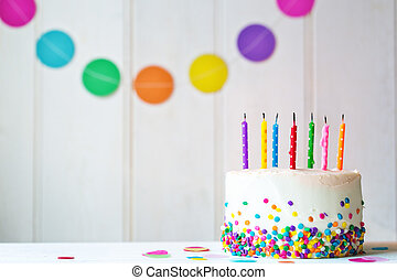 Birthday cake with extinguished candles - Birthday cake with...