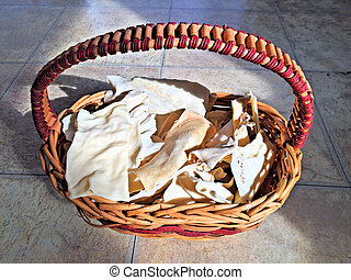 Dog rawhide chewies in a basket - Above view dog rawhide...