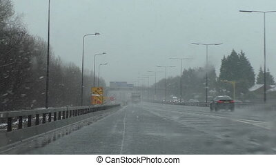 Driving in sleet on highway England - Entering driving...