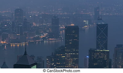 The famous view of Hong Kong from Victoria Peak night to day...