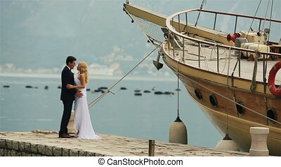 Bride and groom kissing on the berth in Montenegro, Budva -...
